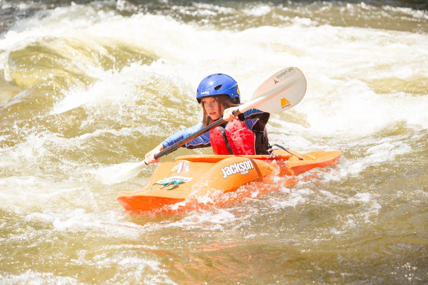 Kids kayaking at summer camp