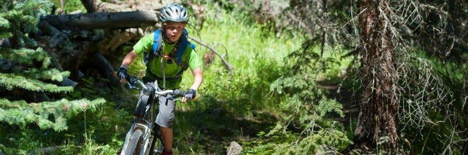 Boy biking at summer camp