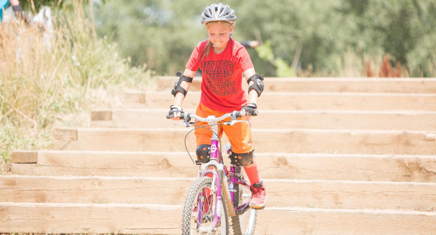 Girl mountain biking Valmont Bike Park