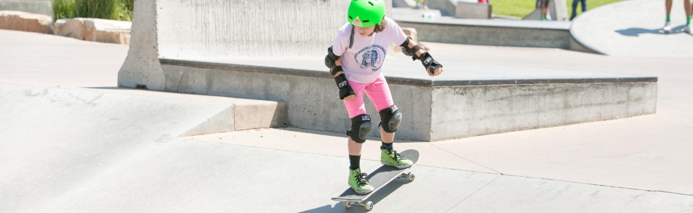 Girl skateboarding at summer camp
