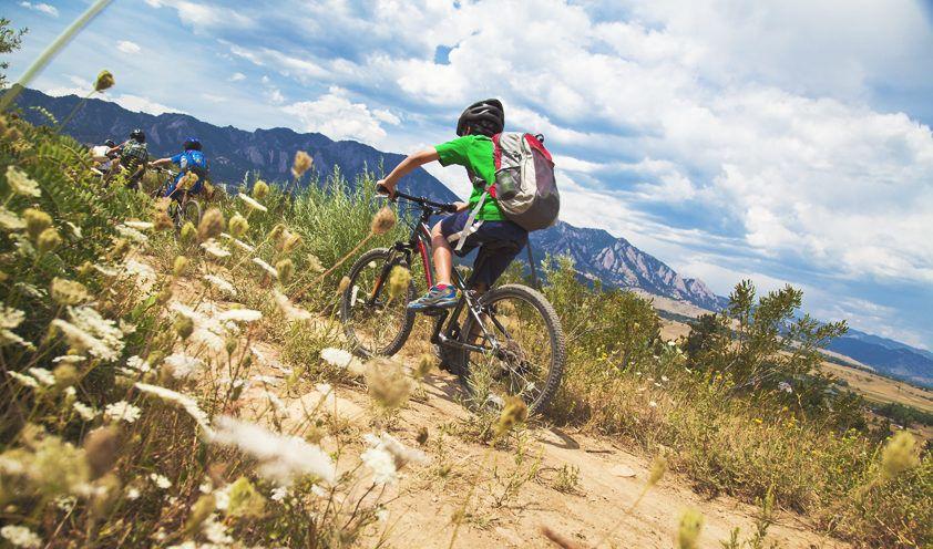kids mountain biking at summer camp