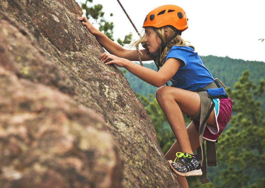 Kids rock climbing at summer camp
